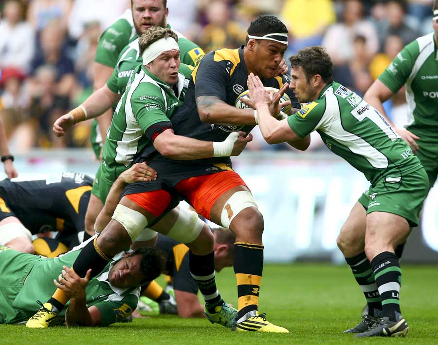 Wasps' Nathan Hughes is tackled by Luke Narraway