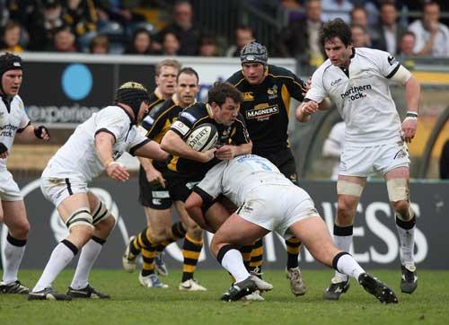 Wasps wing Tom Voyce takes on Newcastle's Carl Hayman