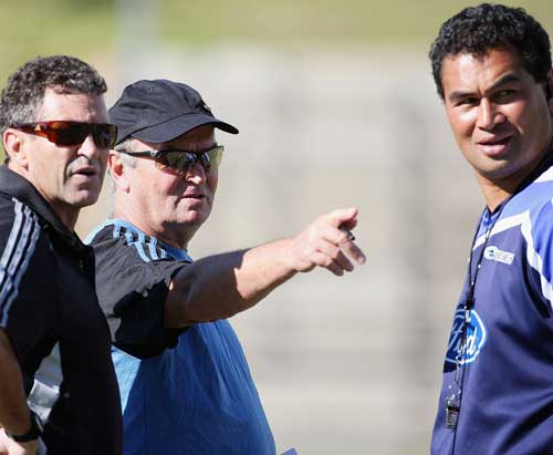 All Blacks coach Graham Henry and assistant Wayne Smith talk with Blues coach Pat Lam