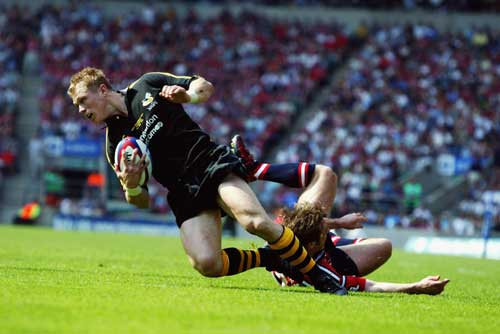 Josh Lewsey is tap tackled
