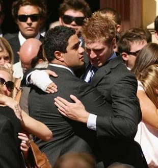 Morgan Turinui and Matt Mackay embrace at the funeral of Brumbies lock Shawn Mackay, Waverley, Sydney, April 15, 2009