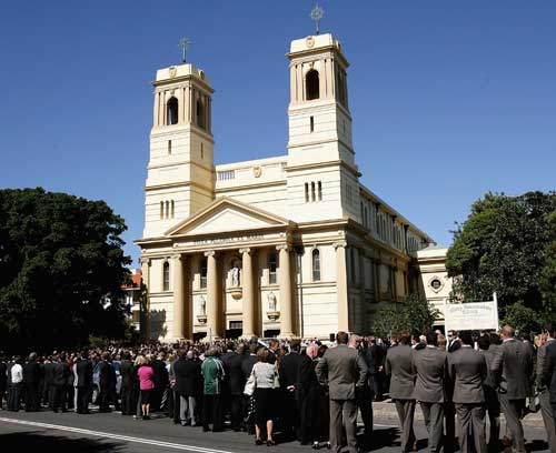 Mourners pack the street outside  Mary Immaculate Church in Sydney's eastern suburbs