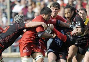 Toulouse's Finau Maka vies with Toulon's Guillaume Ribes