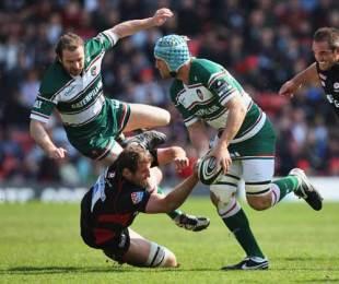 Leicester's Jordan Crane is tackled by Saracens' Chris Jack