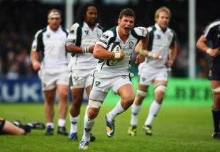 London Irish's Adam Thompstone breaks through to score a try