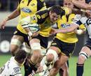 The Hurricanes' Jeremy Thrush takes on the Brumbies' defence