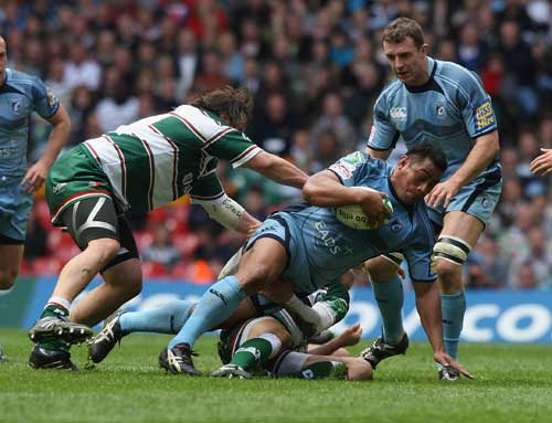 Cardiff Blues' Tauf'au Filise is felled by the Leicester defence