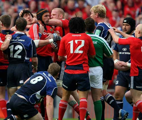 Munster's Alan Quinlan and Leinster's Leo Cullen are separated by team mates