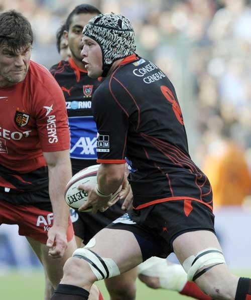 Toulon's Joe van Niekerk looks to offload the ball