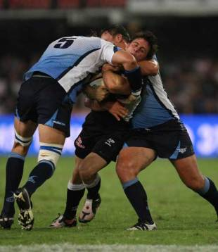 Sharks scrum-half Rory Kockott is tackled by Victor Matfield, Sharks v Bulls, Super 14, Kings Park, Durban, May 16, 2009
