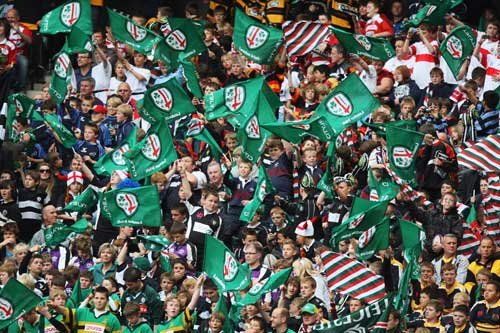 Fans wave flags ahead of the Guinness Premiership Final