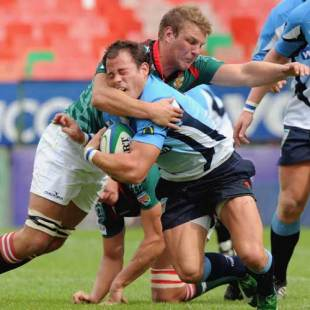 The Blue Bulls' Francois Hougaarg is tackled by the Leopards Wilhelm Koch, Blue Bulls v Leopards, Vodacom Cup, Loftus Versfeld, Pretoria, South Africa, May 2, 2009