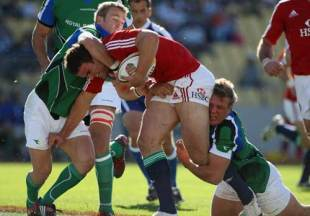 Jamie Roberts is tackled by two defenders in the match between Royal XV and British & Irish Lions, Royal Bakofeng Stadium, Rustenburg, South Africa, May 30, 2009