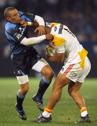 Sona Taumalolo hands off Bryan Habana