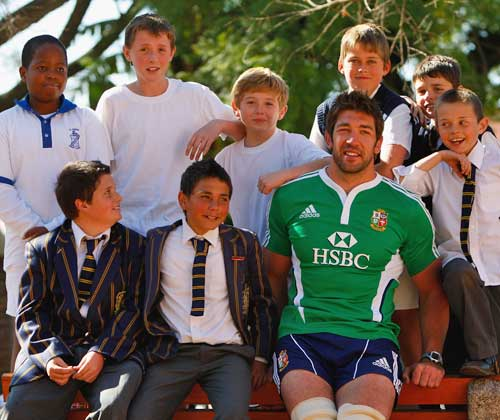 Scotland's Nathan Hines poses with some pupils from St David's School