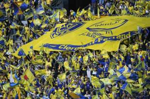 Clermont fans cheer their side with a huge banner