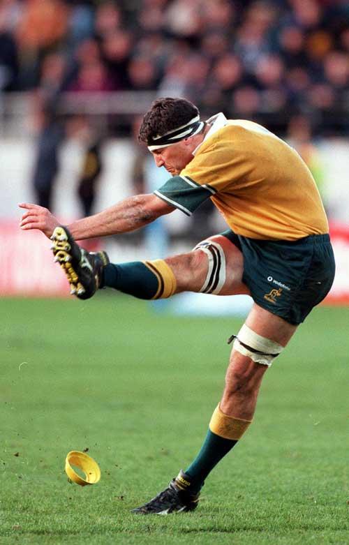 Australia skipper John Eales kicks a penalty