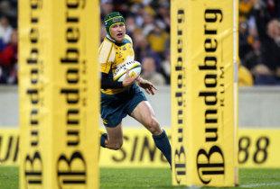 Australia's fly-half Matt Giteau heads over the try line to score