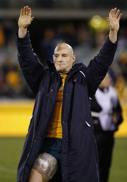 Australia's captain Stirling Mortlock salutes the crowd at the Canberra Stadium