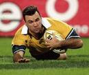 Australia's Joe Roff slides in to score a try