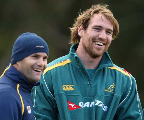 Australia flanker Rocky Elsom shares a joke with former rugby league player Peter Ryan