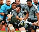All Blacks skipper Richie McCaw fires the ball out of a ruck during training