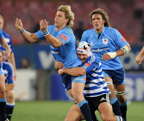 The Blue Bulls' Wynand Olivier off loads the ball under pressure