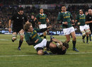 Conrad Smith dives over for the All Blacks to score against the Springboks