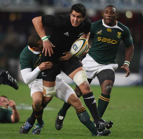 New Zealand lock Isaac Ross is tackled by South Africa's Bryan Habana in Durban
