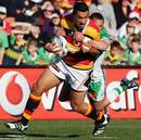 Waikato's Roimata Hansell-Pune is tackled by Manawatu's Aaron Cruden