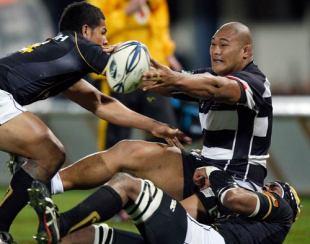 Sona Taumalolo of Hawke's Bay gets tackled by Wellington's Api Naikatini