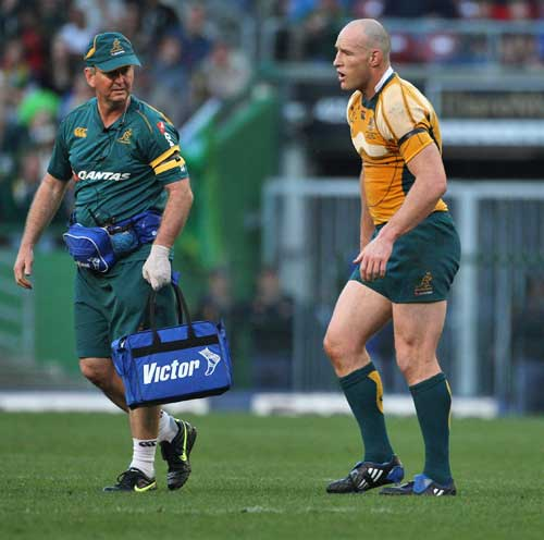 Australia's Stirling Mortlock limps off the field with a knee injury