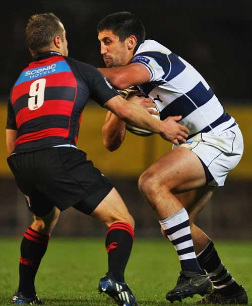Auckland's Paul Williams fends off Canterbury's Tyson Keats