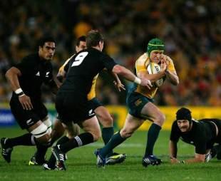 Australia fly-half Matt Giteau attacks a gap in the All Black defence, Australia v New Zealand, Tri-Nations, ANZ Stadium, Sydney,  August 22, 2009