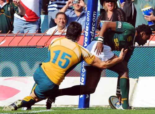 Australia's Adam Ashley-Cooper of Australia fails to stop South African wing Jongi Nokwe from scoring in the corner in Johannesburg