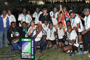 Fiji players pose for a team photo as they celebrate winning the final of the Melrose Cup against New Zealand in the Rugby World Cup Sevens 2005 in Hong Kong, 20 March 2005. Fiji beat New Zealand 29-19 to take the title.