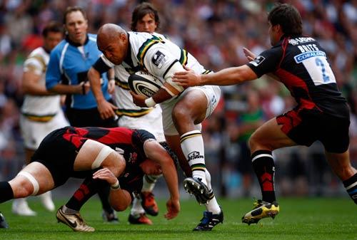 Northampton's Soane Tonga'uiha charges through Sarries duo Rhys Gill and Schalk Brits