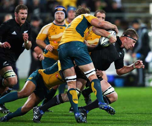 All Blacks lock Brad Thorn is swamped by the Australia defence