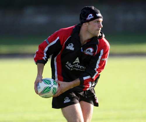 Edinburgh scrum-half Mike Blair waits to pass during training