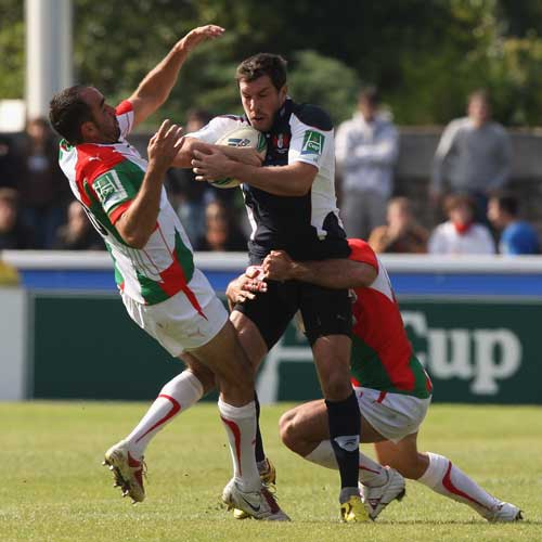 Gloucester's Tom Voyce is wrapped up by the Biarritz defence