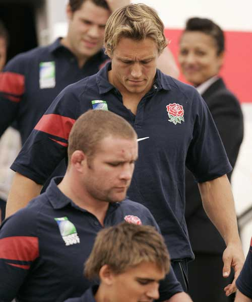 England fly-half Jonny Wilkinson follows his team-mates from the plane