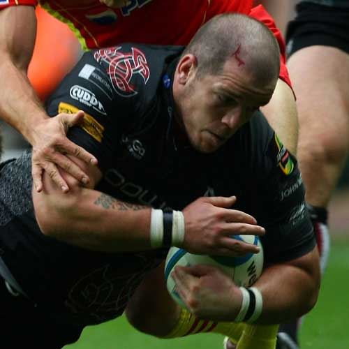 Paul James of the Ospreys is tackled