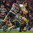 South Africa's Jean Deysel is tackled by the Leicester defence