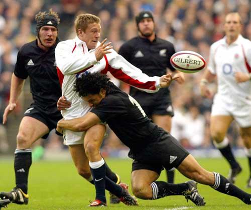 England's Jonny WIlkinson is tackled by New Zealand's Doug Howlett