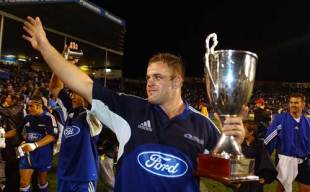 Blues captain Xavier Rush salutes the crowd after his side's thrilling 21-17 victory over the Crusaders in the Super 12 final, Blues v Crusaders, Super 12 final, Eden Park, May 28 2004.