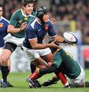 France's Thierry Dusautoir off loads the ball under pressure