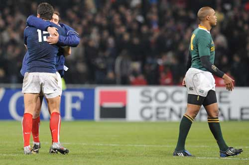 France's Damien Traille and Julien Dupuy celebrate victory over South Africa