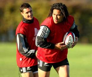 New Zealand centre Ma'a Nonu runs with the ball as fly-half Dan Carter looks on during training at Latymer Upper School, London, November 17, 2009