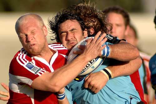 United States scrum-half Tim Usasz tackles Uruguay's Juan Campomar
