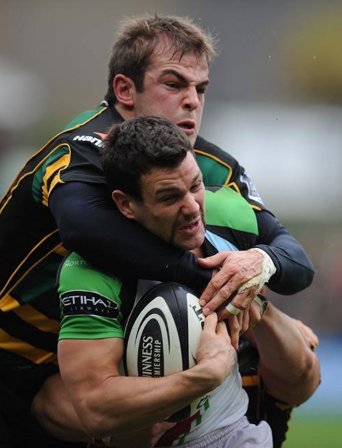 Harlequins' Karl Dickson is tackled by Saints fly-half Stephen Myler